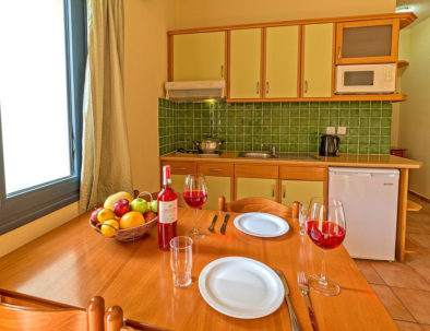 Blue Aegean Hotel & Suite in Gouves - One Bedroom Suite Living Room, Kitchen
